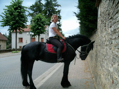 Rider outside Chateau Fontaine-Francaise, historic monument
