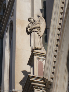 Detail of stone carving on the facade of Santa Croce