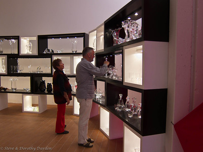 Josephine and Adrian examine some of the glassware.