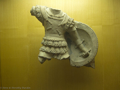 Stone carving, about 6 inches tall, of a Roman gladiator found during excavations