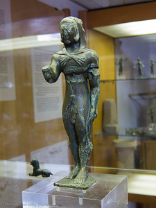 """Bronze votive figure of Hercules wearing the skin of the Nemean lion, a type known as """"di Cipro"""" (from Cyprus). From C. VBC."""