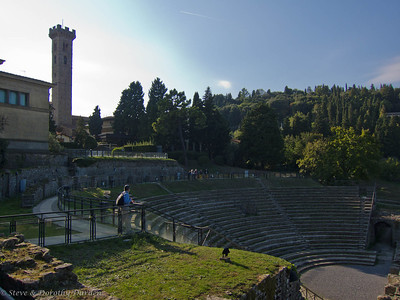 The bell tower of the church in Fiesole stands above the site.