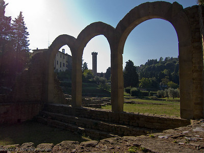 The Fiesole town bell tower and the Roman arches.