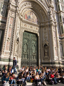 Students on an art field trip were drawing the  Baptistery doors, with the facade of the Duomo behind them.