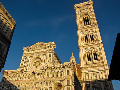 The facade of the Duomo, the dome and the campanile