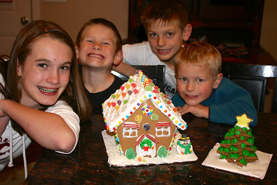 Every year, the kids do a gingerbread house.  This was a kit that I found at Costco which was so easy to assemble and all the kids could participate in decorating it!