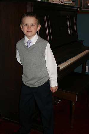 """Luke began piano lessons in November and had his first recital in December!  He played """"Wish You A Merry Christmas"""" and nailed it!  So proud of him!  He has actually enjoyed practicing--yay!"""