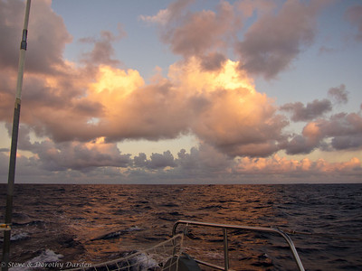 Sunrise brought pink clouds astern.
