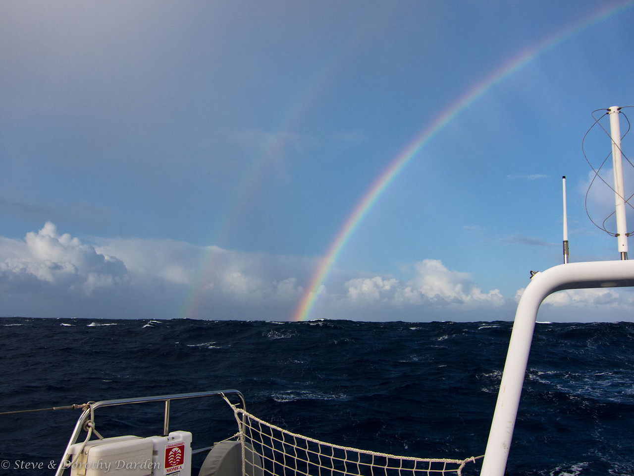 Double rainbow astern