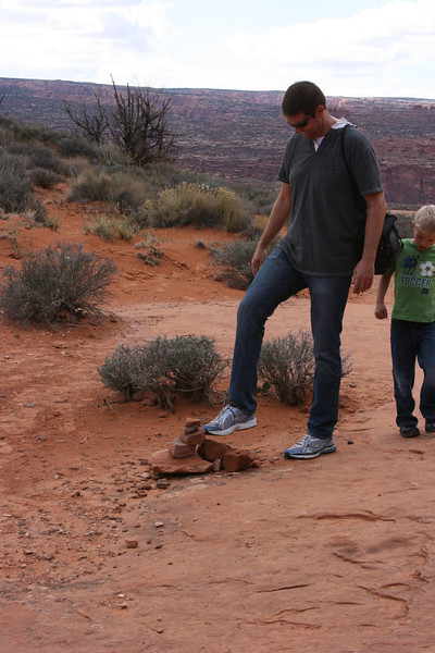 Robb always teases that he is going to tip over all the trail markers!