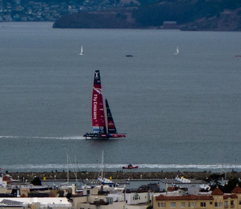 ETNZ  foiling along the San Francisco city front.