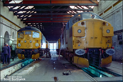 37114 & 26038 undergo maintenance inside Inverness TMD at 1030 on 21/07/1983.