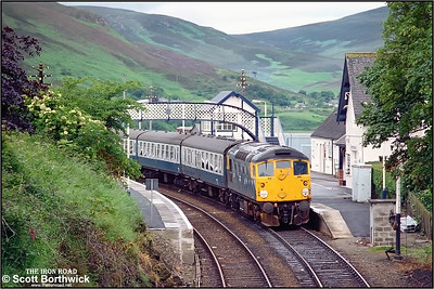 26037 stands at Helmsdale on 17/07/1985 arfter running round the empty stock off the unadvertised Wednesdays only (03/07-28/08) 1H67 1015 Inverness-Dunrobin Castle. As no run round facilities exist at Dunrobin Castle the train had to run further north. However as the service trains to Wick/Thurso were booked to cross at Brora the ECS had to run still further north to Helmsdale in order to run round. Here 26037 is seen awaiting departure time with 5H68 Helmsdale-Dunrobin Castle prior to working the return service 1H68 1500 Dunrobin Castle-Inverness.