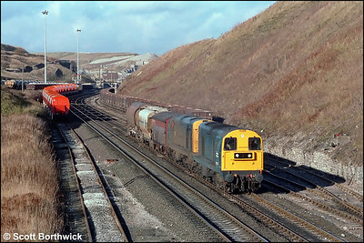 20145+20068 set off from Peak Forest South SS with a trip working to Briggs Sdgs, Hindlow on 20/11/1986.