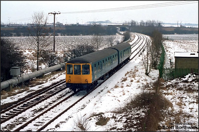 54179+53536 depart from Ridgmont with the 1058 Bedford-Bletchley service on 18/02/1986.