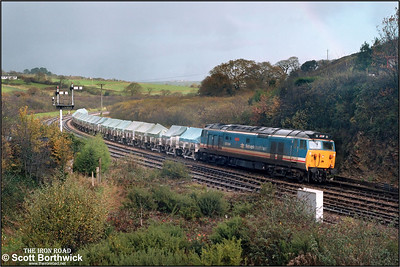 50044 'Exeter' is recessed in the loop to the east of Par station on 23/11/1987 with a Tavistock Junction-Burngullow china clay empties.