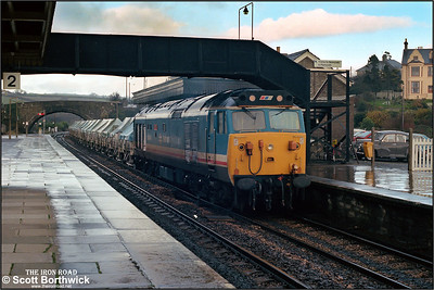 50044 'Exeter' passes through Par during a heavy shower on 23/11/1987 with a Tavistock Junction-Burngullow china clay empties.
