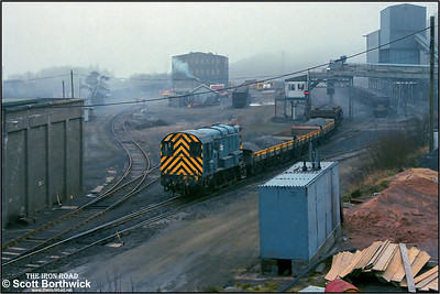 With morning fog hanging on Dartmoor, 08584 is pictured at Meldon Quarry whilst outbased as the quarry pilot on 18/02/1988. When not in use the loco would stable in the concrete shed visible to the left.