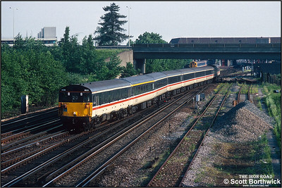 Class 489 (GLV) 9108 leads the 1820 Gatwick Airport-London Victoria service away from Gatwick Airport on 26/05/1992. 73208 'Croydon 1883-1983' was on the rear.