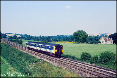 150261 forms the 1031 SX Bristol Temple Meads-Southampton service passing the Church of St Nicholas of Mira at Little Langford on 31/07/1992.