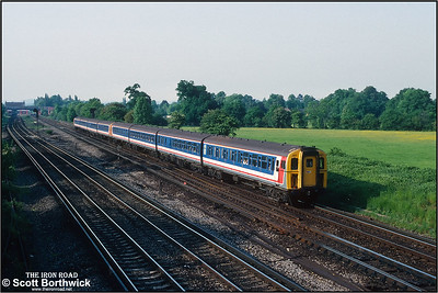 A pair of class 423/1 (4-VEP) units 3517+3476 approach Gatwick Airport whilst forming the 1733 SX London Bridge-Brighton/Lewes on 26/05/1992.. The train would split at Haywards Heath with the front four coaches going forward to Brighton and the rear four to Lewes.