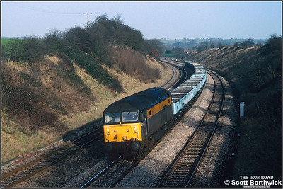 47975 passes Stoke Prior with an unidentified working comprising a rake of 32 empty Mercury Telecom ZDW's on 08/01/1993.