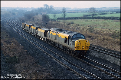 37049 passes Clay Cross Jnct whilst working a short 8E85 1015 Bardon Hill Quarry-Healey Mills SS ballast on 01/02/1993.