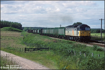 47314 'Transmark' passes Orbliston whilst working 6M64 1736 MThO Elgin-Dee Marsh Jnct on 12/07/1993. At this point in the journey the train comprised both loaded and empty wagons with timber having been loaded at Elgin with more to be loaded at Huntly.