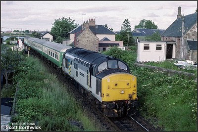 37428 'David Lloyd George' eases away from the swing bridge at Clachnaharry whilst in charge of 2H87 1838 Inverness-Kyle of Lochalsh on 12/07/1993.