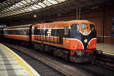 Class 141, number 146 sits under the overall roof of Cork station with the 1315 Cork-Tralee service on 30/09/1998.