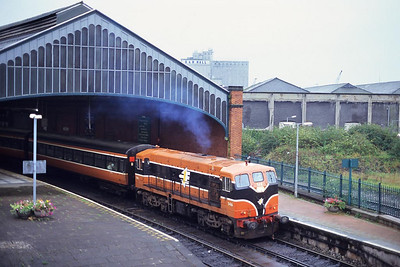 Class 141, number 146 thrashes out of Cork station with the 1315 Cork-Tralee service on a dismal 30/09/1998.