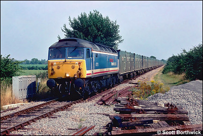 47711 'County of Hertfordshire' powers 4C13 1111 Calvert-Bristol Barrow Road RTS ety refuse containers at Islip on 10/08/1998.