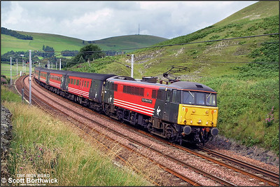 86206 'City of Stoke on Trent' heads south through the Scottish borders approaching Crawford with an unidentified working on 16/08/2001.