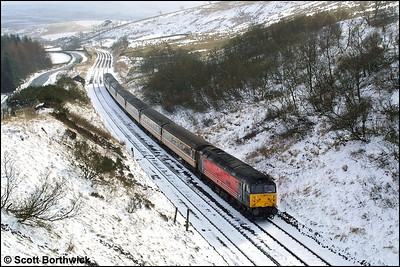 47741 'Resilient' heads north approaching Shotlock Hill Tunnel with 1S54 0550 Bournemouth-Edinburgh Waverley on 23/02/2002.