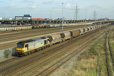 60096 had plenty of china clay empties in tow when pictured at Washwood Heath on 21/03/2002 hauling 6V70 0858 Cliff Vale-St Blazey SS.