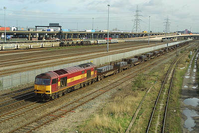 60052 passes Washwood Heath on 21/03/2002 whilst working 6V40 0602 Lackenby-Llanwern steel slabs.