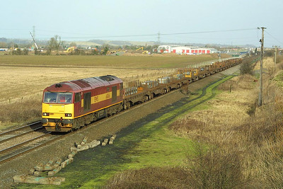 60016 passes Catholme on 28/01/2002 with 6V36 0815 Lackenby-Margam stell slabs.