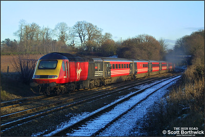 43068 'The Red Arrow's' brings up the rear of a diverted Virgin Cross Country service at Whitacre Junction on 05/01/2003. The set is clearly missing a couple of coaches from its formation and has 43157 leading.