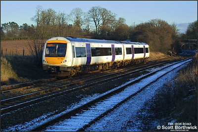 170399 works an eastbound service at Whitacre Junction on 05/01/2003.