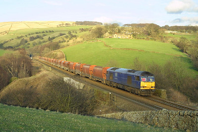 In fading evening sunlight, 60078 passes Wash with 6M87 1105 TuThO Ely-Peak Forest South SS empties on 23/03/2004.