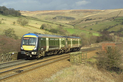 The sun picks out the detail of 'Birmingham Bull Ring' liveried 170505 as it passes Wash, near Chinley on 23/03/2004 with 1L21 1252 Liverpool Lime Street-Norwich.