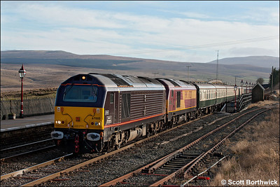 67005 'Queen's Messenger'+67027 'Rising Star' pass through Ribblehead on 21/01/2006 with 1Z27 0543 Bristol Temple Meads-Carlisle, 'The Settle & Carlisle Flyer' operated by Past-Time Railtours.
