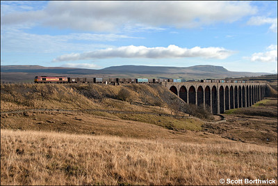 60021 'Pen-y-ghent' working 6M52 1016 Drax Power Station-Newbiggin is pictured coming off the magnificent Ribblehead Viaduct and onto Blea Moor on 21/01/2006. The mountain after which the locomotive was named dominates the background.
