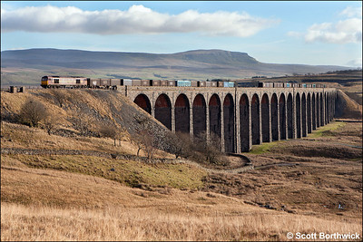 60021 'Pen-y-ghent' powers a load of gypsum northwards with 6M52 1016 Drax Power Station-Newbiggin as it crosses the magnificent Ribblehead Viaduct on 21/01/2006. The mountain after which the locomotive was named dominates the background.
