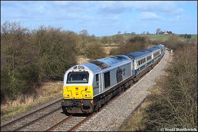 67029 'Royal Diamond' passe Holmes House Farm, Bishops Itchington running 45 minutes late with 1P03 0723 Wrexham General-London Marylebone on 09/03/2009.