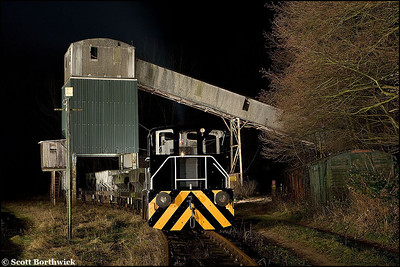Oakamoor's resident shunting locomotive, Yorkshire Engine Company 0-4-0DH, 'Brightside' stands under the former British Industrial Sand loading bunker at Oakamoor on 03/01/2009.