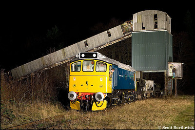 25322 'Tamworth Castle' stands under the former British Industrial Sand loading bunker at Oakamoor on 03/01/2009.