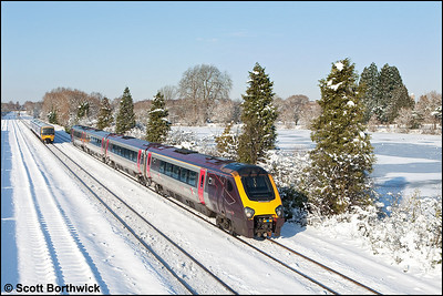 Running 65 minutes late, 220030 passes Hinksey whilst forming 1V84 0723 Newcastle-Reading as 165107 scurries towards journeys end with 1D31 1150 London Paddington-Oxford on 07/01/2010.