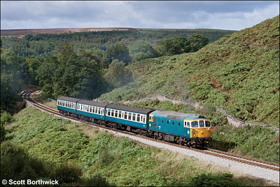 33108 makes its second trip of the day on the Goathland shuttle climbing the bank at Thomason Foss whilst working 2A33 1210 Grosmont-Goathland on 14/09/2012.