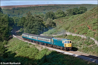 33108 thrashes up the bank at Thomason Foss whilst working 2A31 1010 Grosmont-Goathland on 14/09/2012.